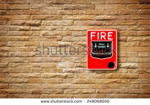 stock-photo-fire-break-glass-alarm-switch-on-the-stone-wall-249068050